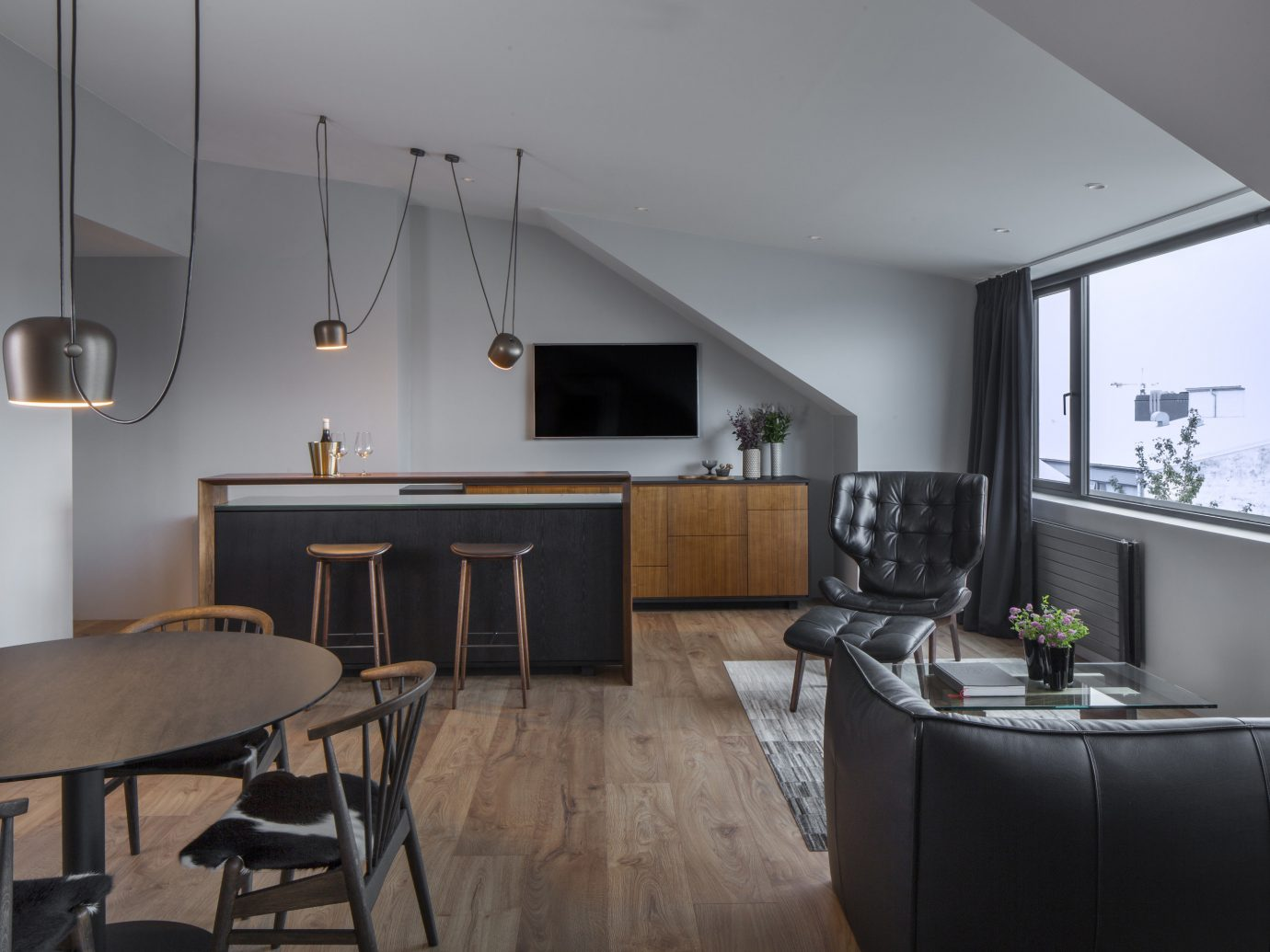 Boutique Hotels Hotels Iceland Outdoors + Adventure Reykjavík Road Trips indoor wall floor room chair interior design ceiling Architecture Living living room table loft real estate house interior designer apartment furniture area