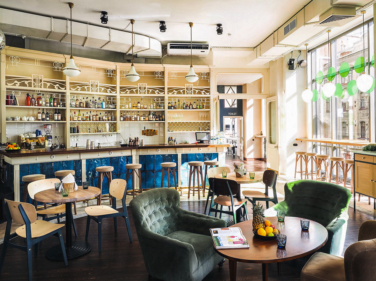 Arts + Culture Hotels Jetsetter Guides indoor table chair interior design restaurant ceiling café coffeehouse Bar area furniture