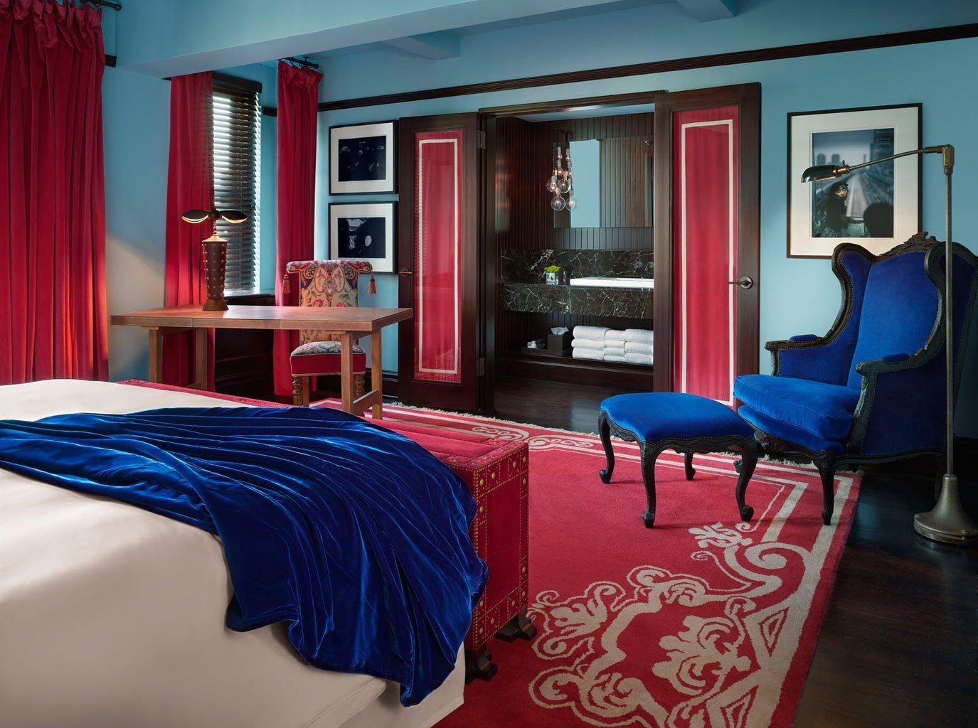Hotels Offbeat indoor room wall floor red window bed property Living house Suite interior design furniture home living room Bedroom estate real estate cottage apartment blue decorated area bright colorful