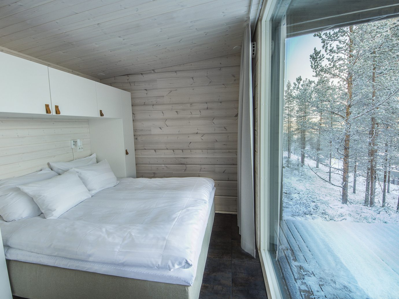 Finland Trip Ideas indoor bed wall room property window Architecture ceiling home house real estate Bedroom snow interior design wood bed frame daylighting floor Winter