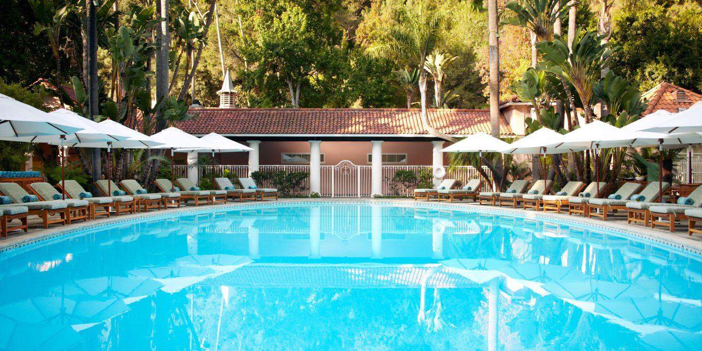 Grounds Hotels Pool Wellness tree outdoor swimming pool leisure Resort estate resort town backyard Villa blue swimming several