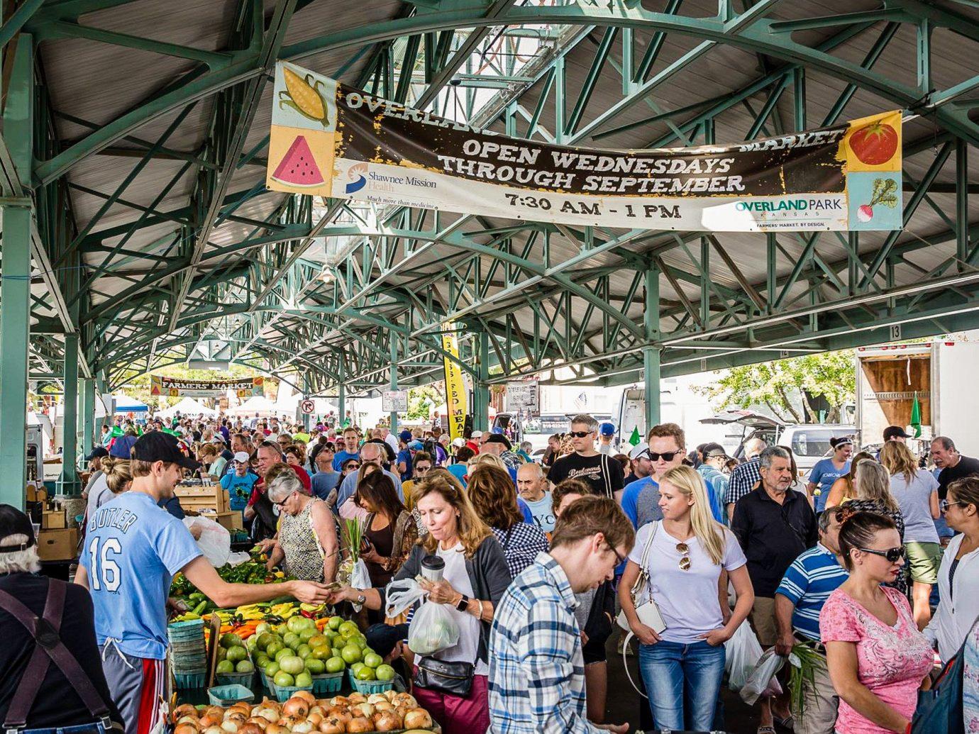 Kansas City Midwest Trip Ideas person building market marketplace public space crowd bazaar City people stall flea market tourism fair vendor fun produce