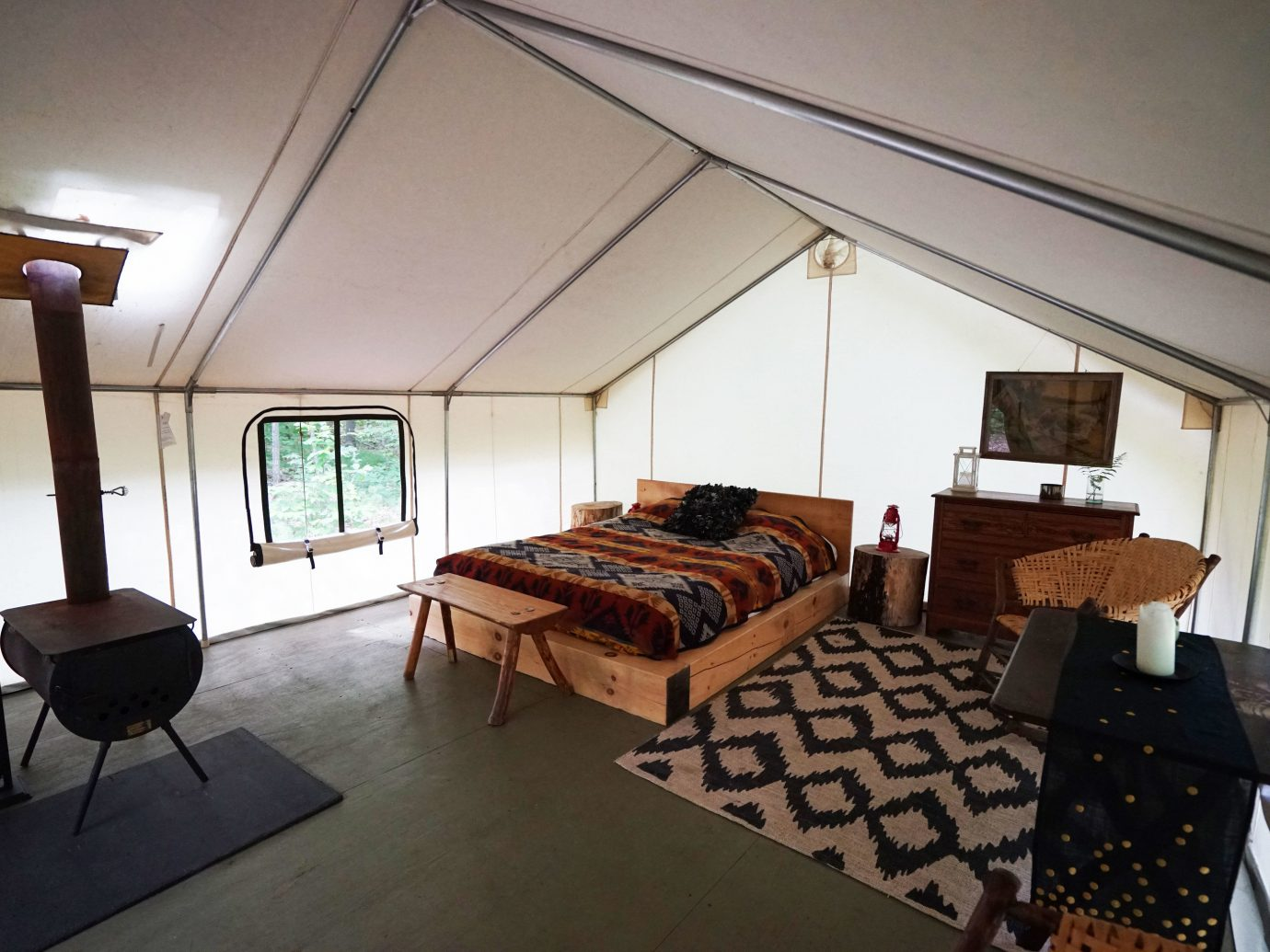 Glamping Luxury Travel Outdoors + Adventure Weekend Getaways indoor floor wall room Living property ceiling building house estate Villa living room cottage home furniture real estate interior design Suite Design apartment condominium area several
