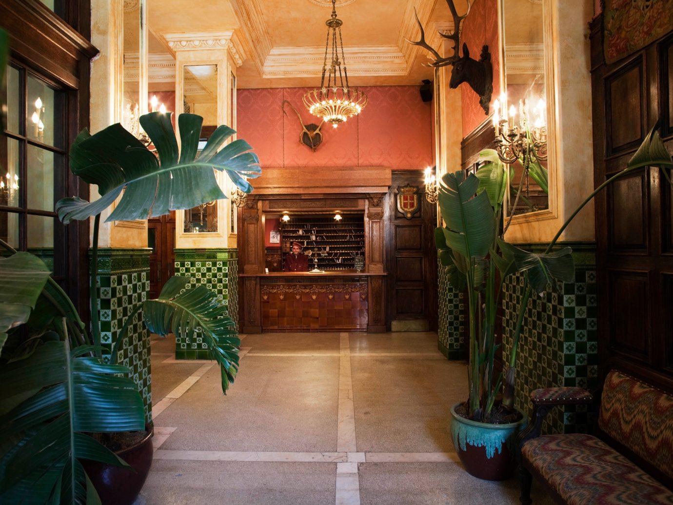 Budget Trip Ideas floor indoor room property estate Lobby house mansion home green interior design living room Resort cottage palace furniture