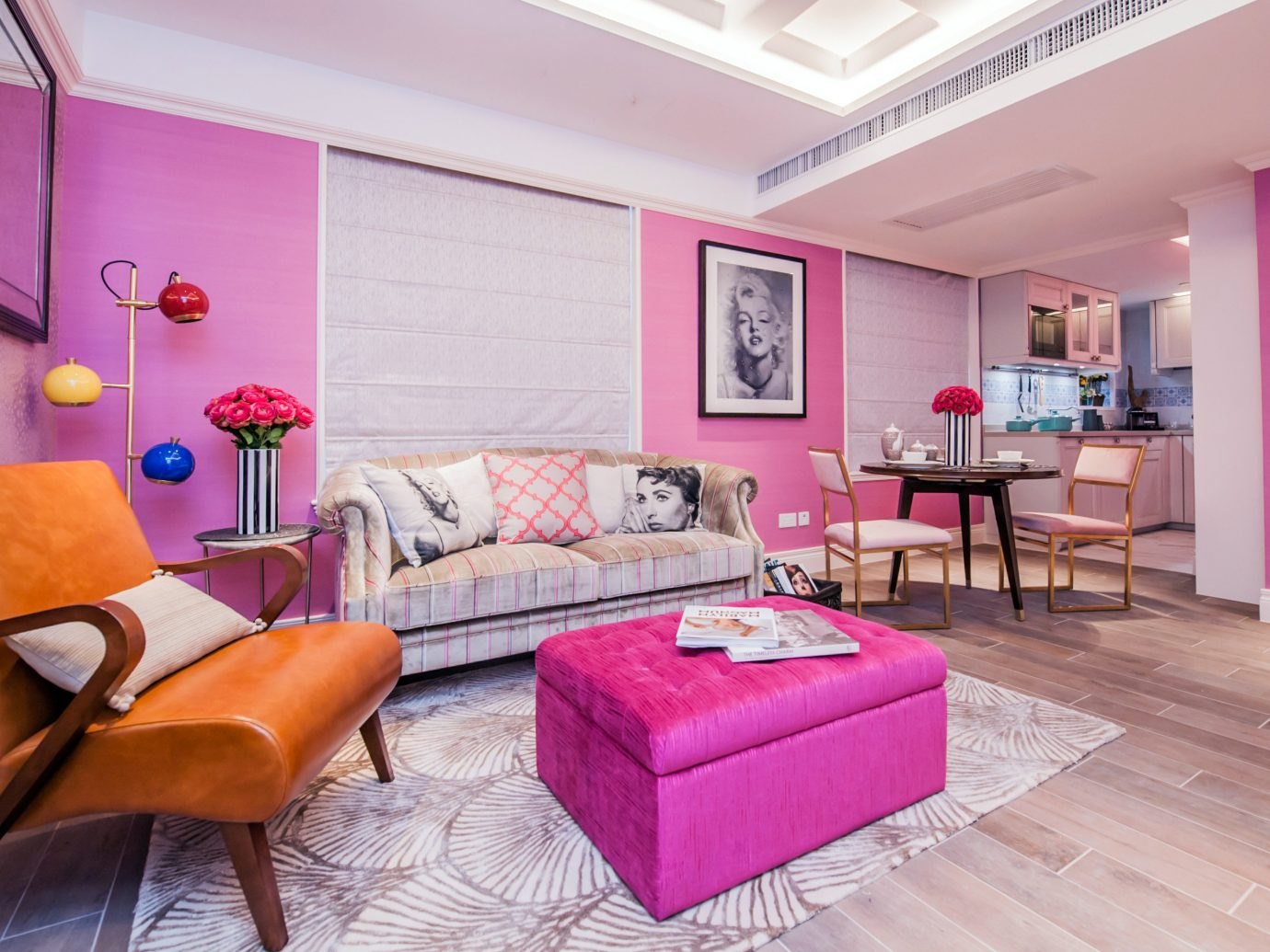 Hotels floor indoor wall room Living pink property ceiling living room real estate Bedroom home interior design hardwood estate furniture Suite cottage bed sheet apartment purple colored