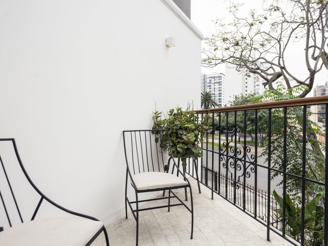 Boutique Hotels Hotels property handrail building Balcony home house real estate apartment chair tree outdoor structure stairs estate window furniture Fence plant area