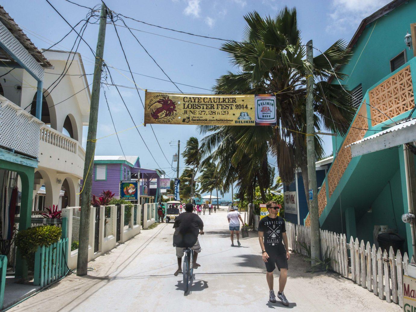 caribbean Secret Getaways Trip Ideas sky outdoor Town neighbourhood road vacation walkway street tourism Downtown pedestrian boardwalk sign
