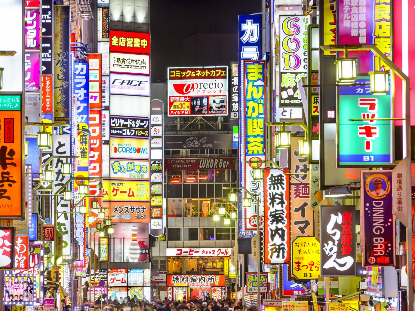 building many outdoor road City metropolis urban area street retail sign window area cityscape convenience store colorful night several colored