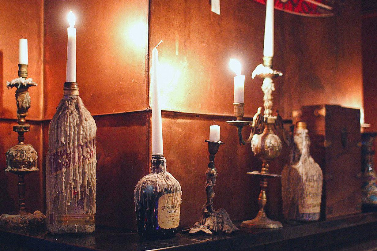 Arts + Culture Hotels Jetsetter Guides indoor bottle distilled beverage glass bottle liqueur Drink drinkware alcohol wine light fixture still life photography interior design candelabrum Bar lamp