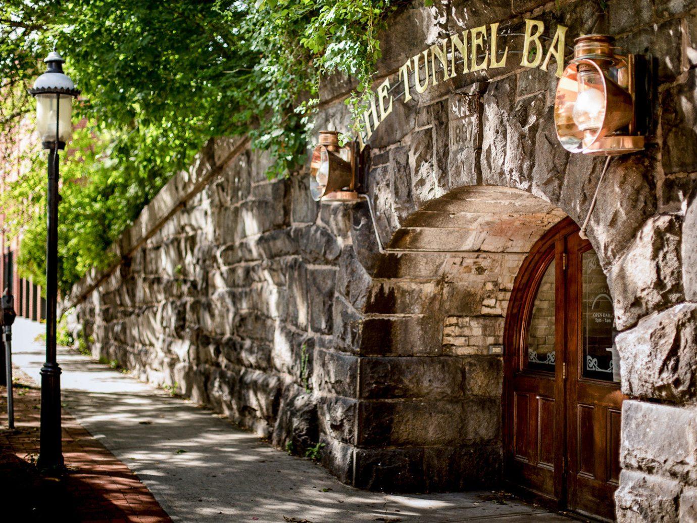 Boutique Hotels Fall Hotels Outdoors + Adventure Trip Ideas Weekend Getaways building outdoor tree way stone street alley arch plant road sidewalk