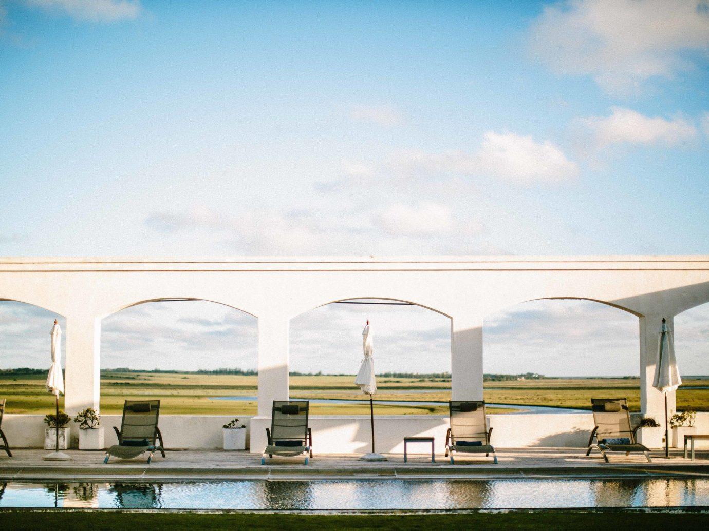 Beach Romantic Getaways south america Trip Ideas Uruguay bridge sky water fixed link reflection cloud