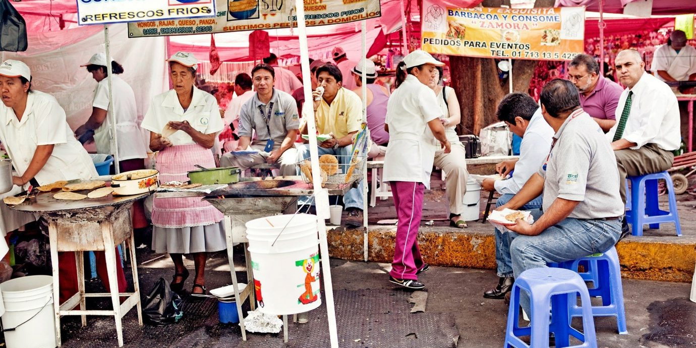 Food + Drink person marketplace City public space vendor market human settlement bazaar people street food food group cuisine stall