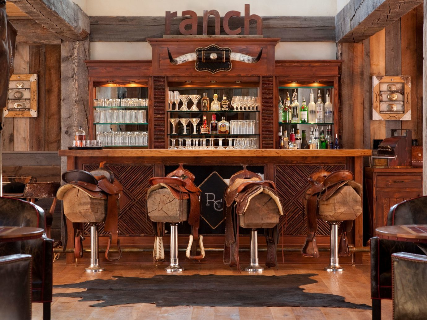 Bar bar seating cozy Drink Elegant extravagant fancy Lounge Luxury regal Rustic sophisticated Trip Ideas warm indoor floor Living building estate restaurant interior design wood home tavern ancient history tourist attraction furniture