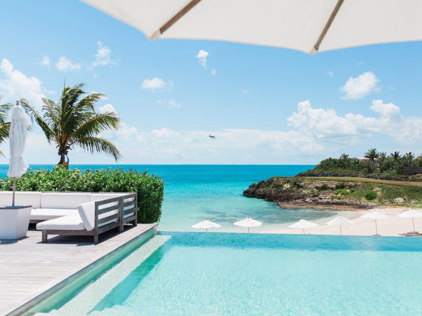 Hotels sky swimming pool outdoor caribbean property vacation leisure Sea Resort Beach Ocean estate Lagoon bay Villa Pool Island shore day