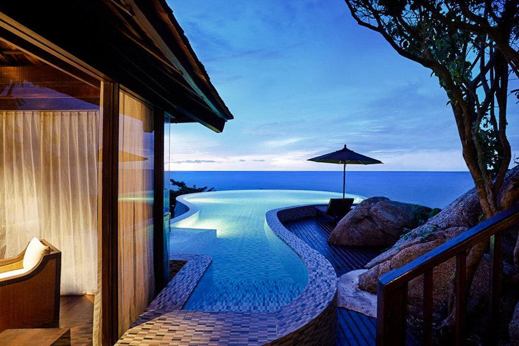 Hotels property Resort swimming pool bed Sea sky estate vacation real estate tropics hotel resort town Villa amenity overlooking