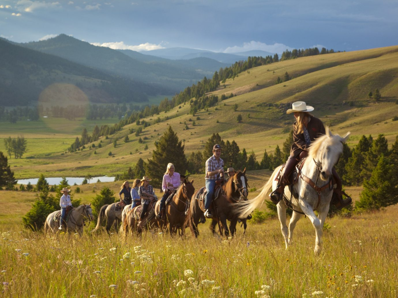 Trip Ideas grass mountain outdoor sky pasture horse grassland trail riding natural environment field herd plain grazing steppe prairie meadow landscape rural area Nature horse like mammal animal sports equestrianism Ranch highland bovine hillside