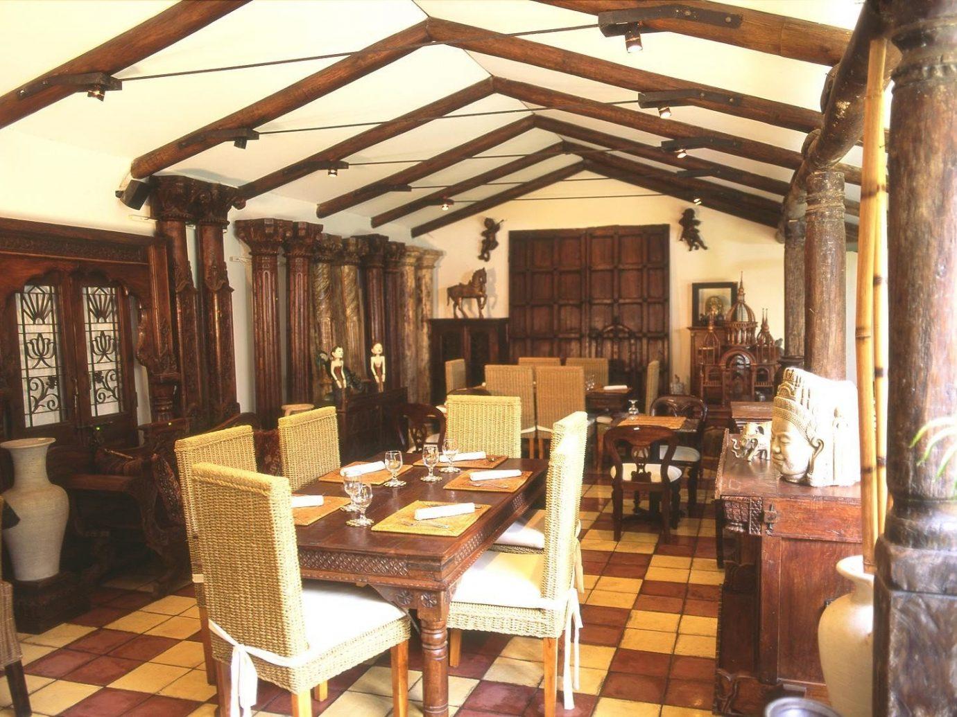 Food + Drink Trip Ideas table indoor floor chair property restaurant Dining interior design furniture