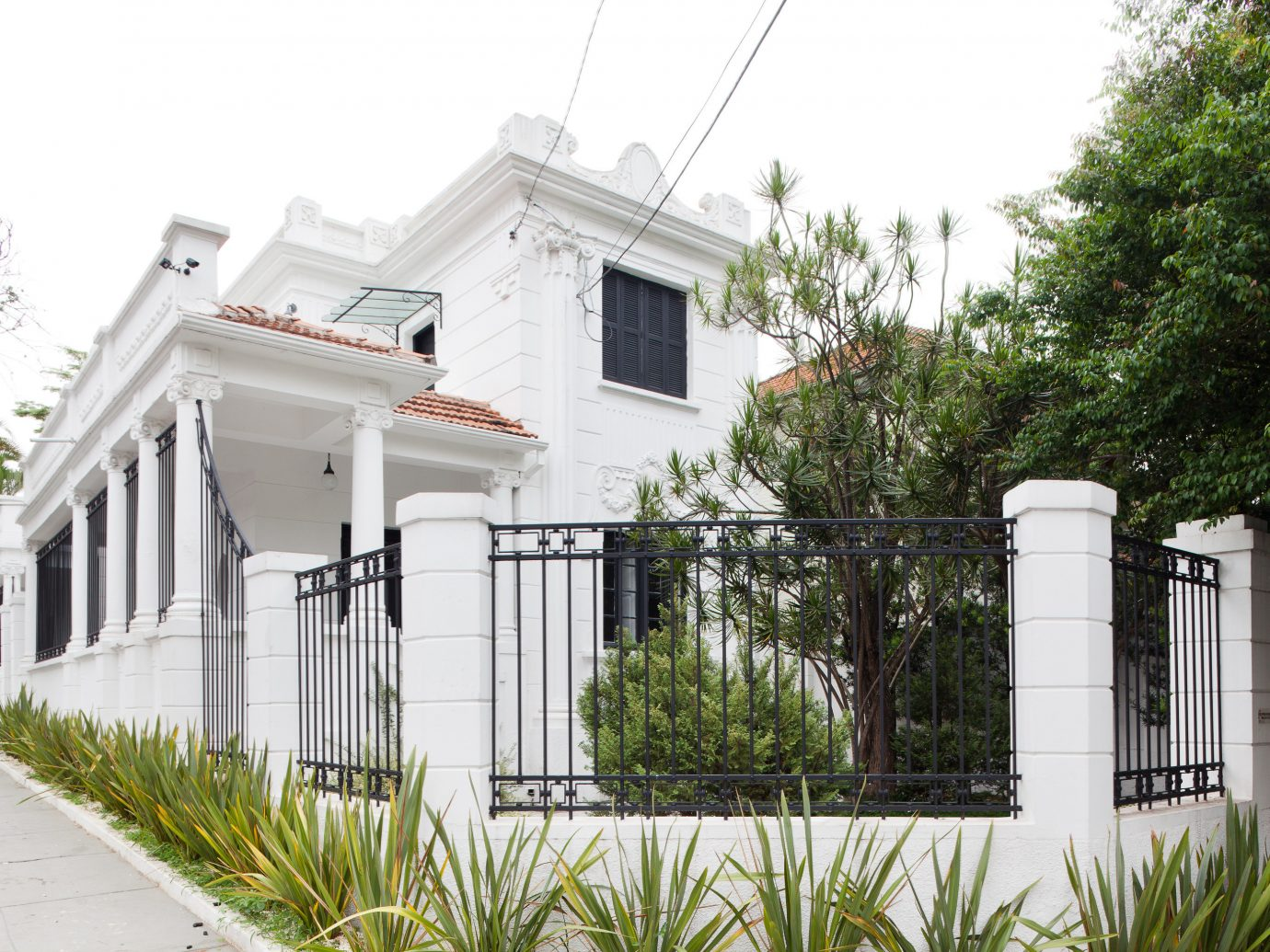 Hotels outdoor tree sky building house property home residential area estate neighbourhood Architecture facade siding Villa suburb cottage real estate mansion Fence outdoor structure