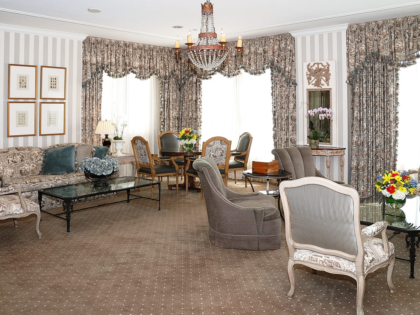 City Classic Hotels Living floor room indoor chair dining room property living room furniture estate home interior design real estate cottage porch farmhouse area decorated several