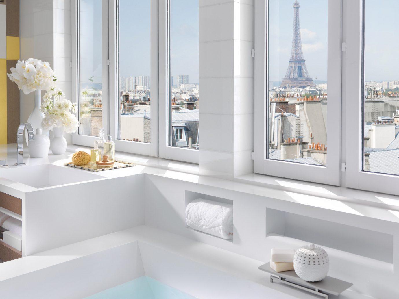 Hotels Luxury Travel window indoor room bathroom interior design tap home bathtub plumbing fixture sink Suite bathroom cabinet bathroom accessory angle