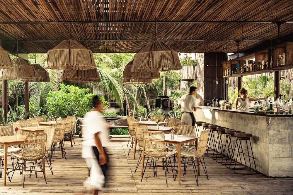 Boutique Hotels Hotels Mexico Tulum chair table estate backyard wood Dining restaurant barn outdoor structure farmhouse furniture porch area