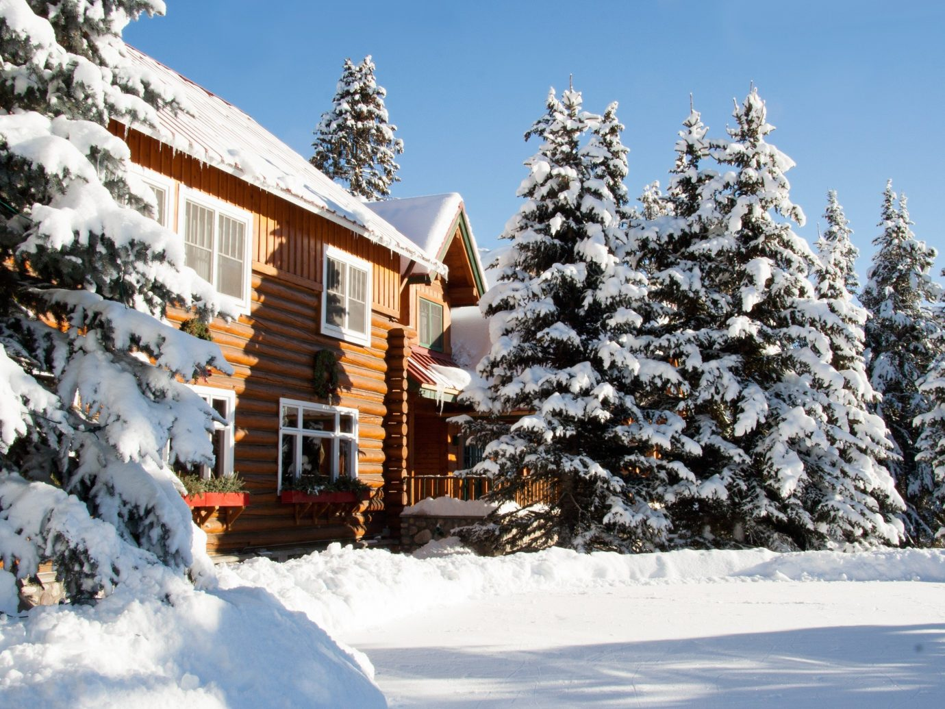 Hotels snow outdoor tree sky Winter Nature weather covered season geological phenomenon Resort woody plant fir piste mountain range spruce house surrounded