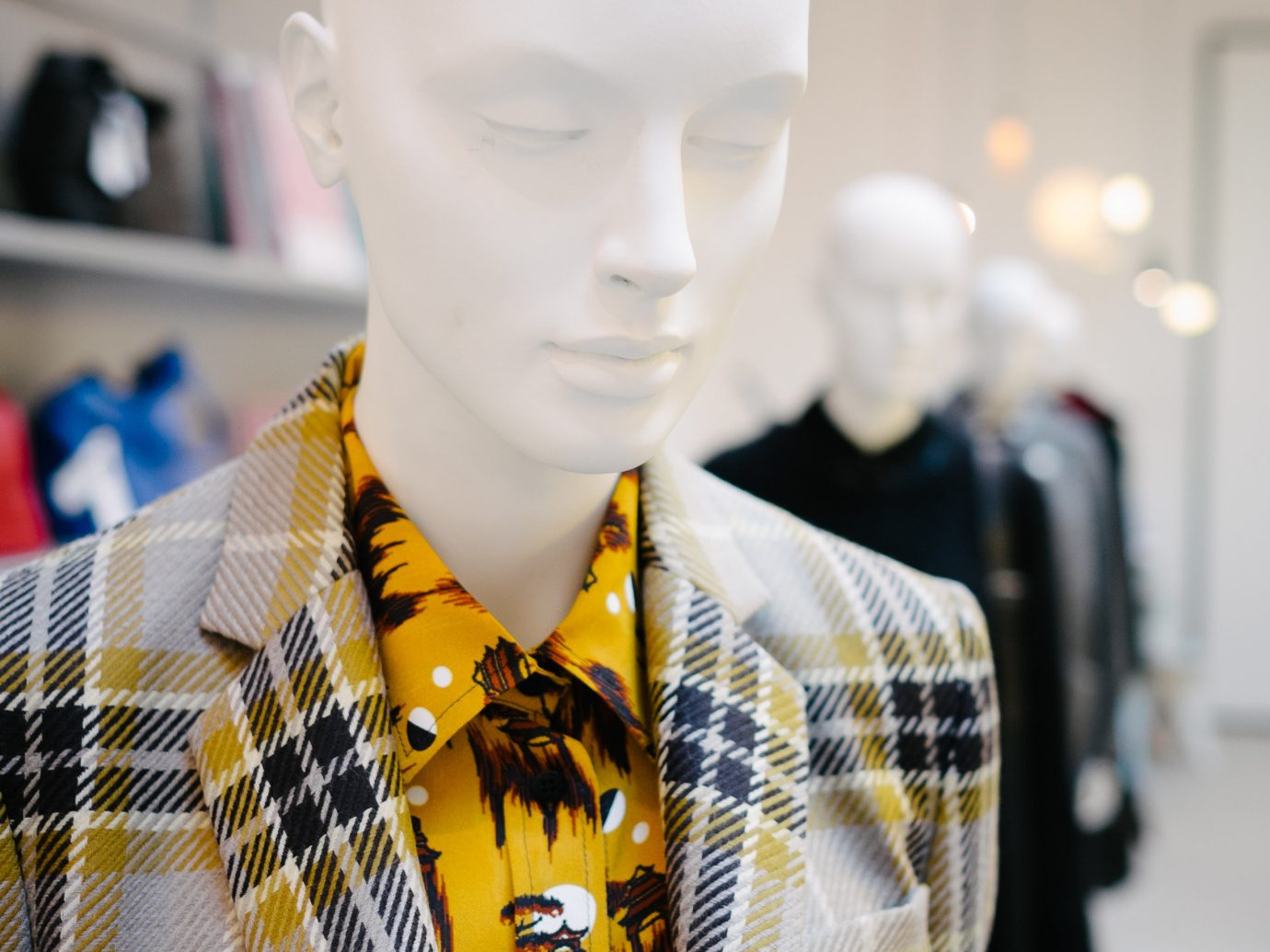 shopping Style + Design Travel Trends Trip Ideas person indoor mannequin yellow wearing Design