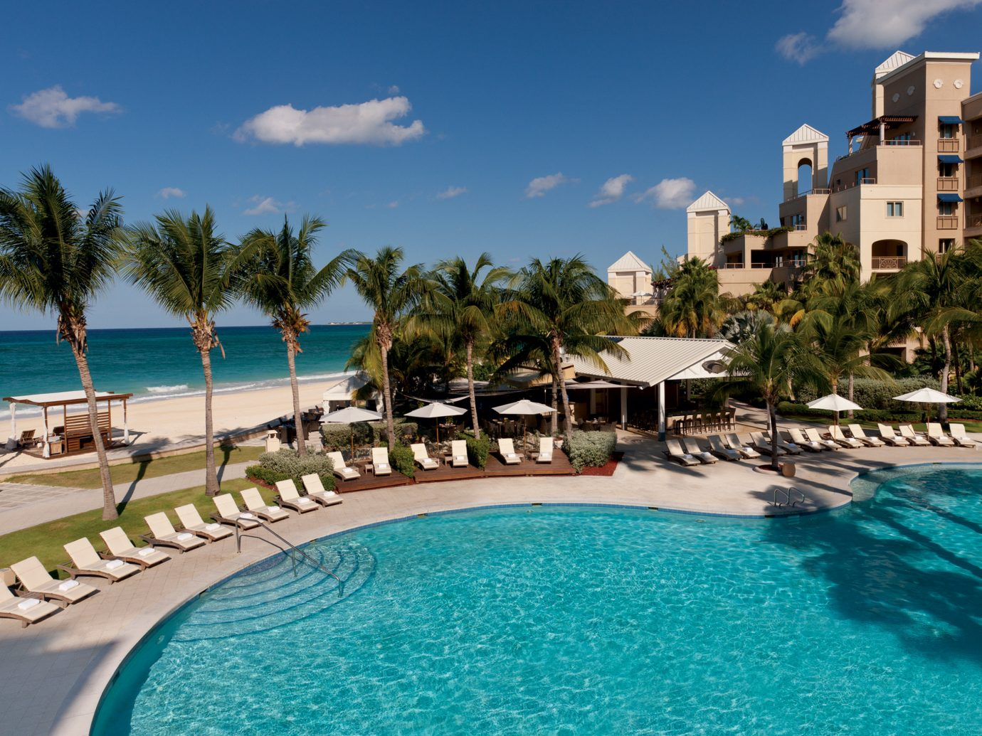 Beachfront Exterior Hotels Luxury Pool Trip Ideas water Resort sky outdoor umbrella swimming swimming pool Beach property leisure vacation estate marina resort town condominium Sea caribbean palm bay lawn Lagoon blue lined reef