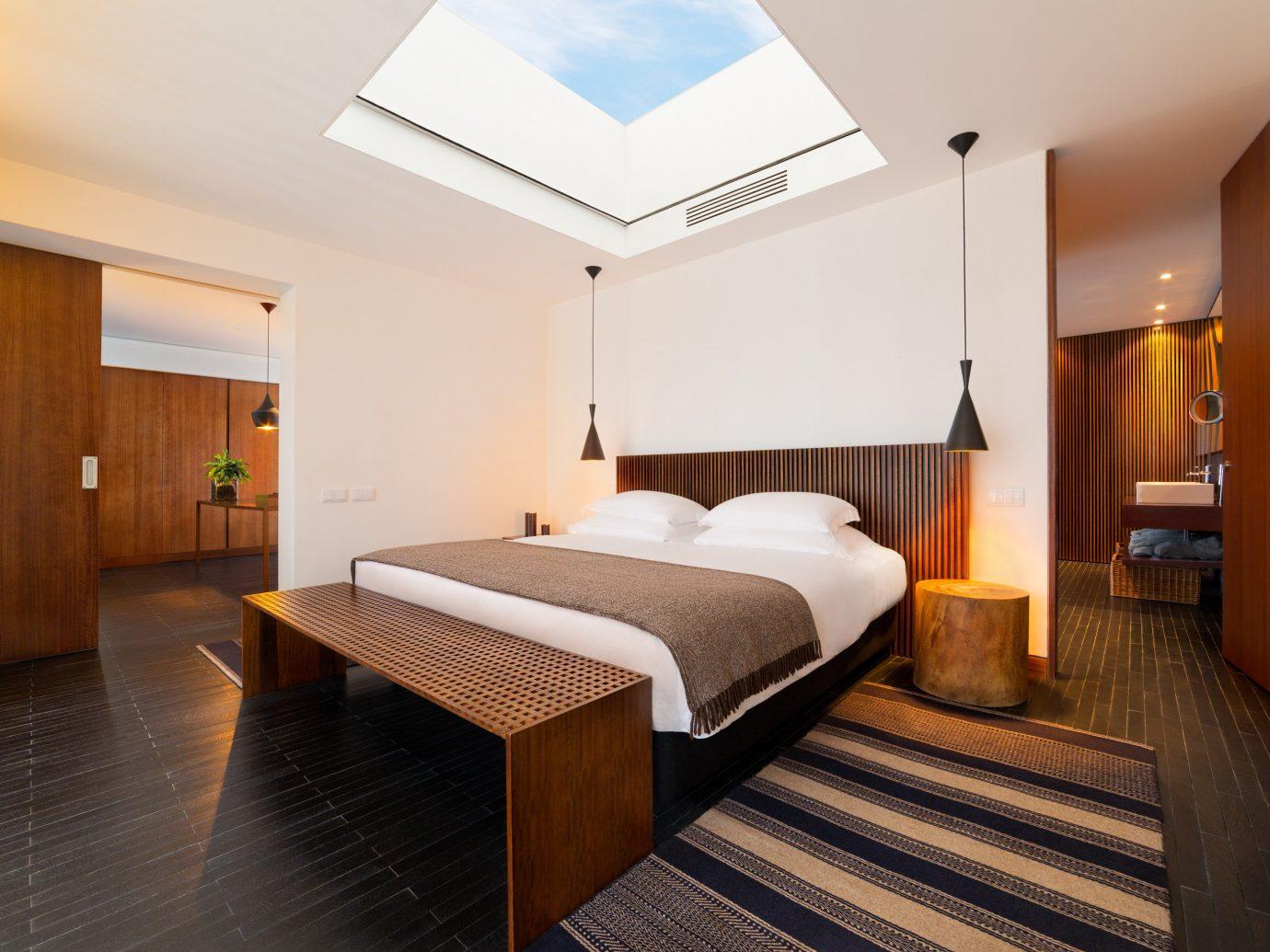 Hotels Offbeat indoor wall floor bed ceiling room property Suite Bedroom real estate estate hardwood cottage Resort hotel furniture
