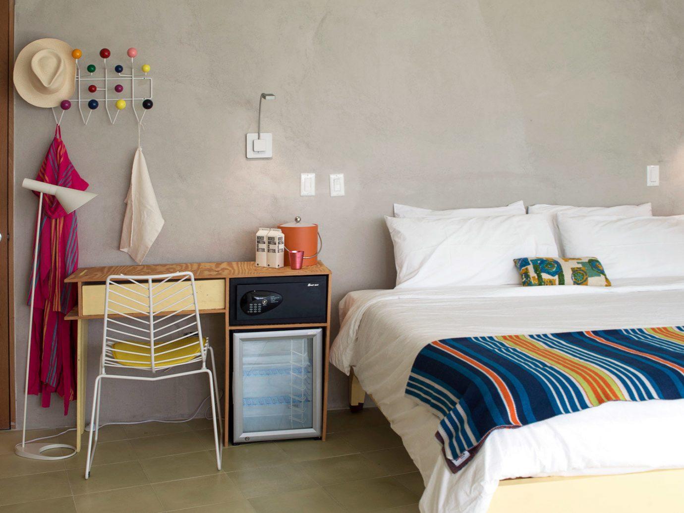 Bedroom Boutique Design Hip Hotels Modern floor indoor wall room bed property interior design home cottage furniture bed sheet living room Suite estate apartment tiled