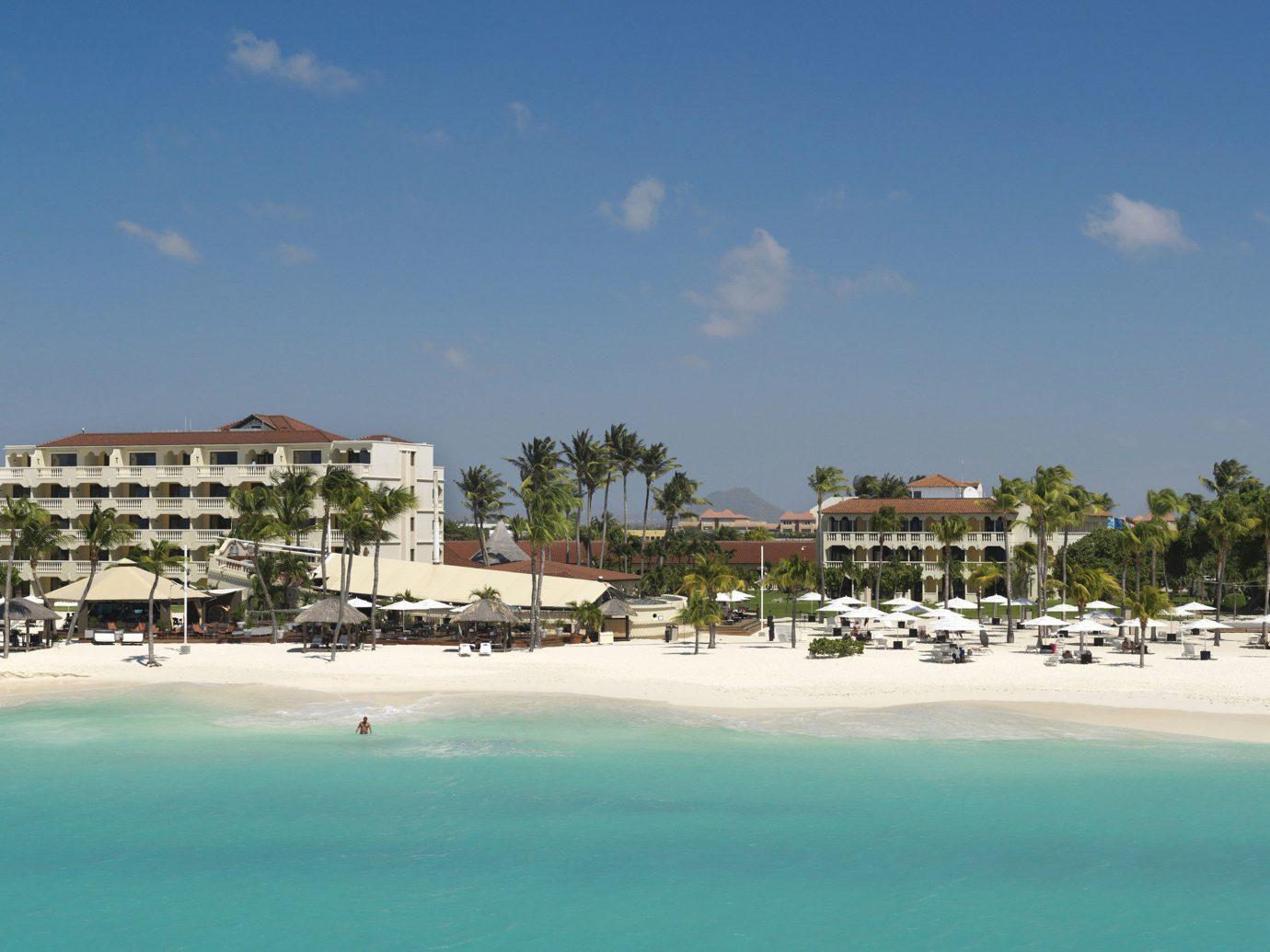 Aruba Hotels sky outdoor Beach Nature shore body of water Sea Resort vacation Ocean Coast caribbean bay Lagoon marina cape sandy