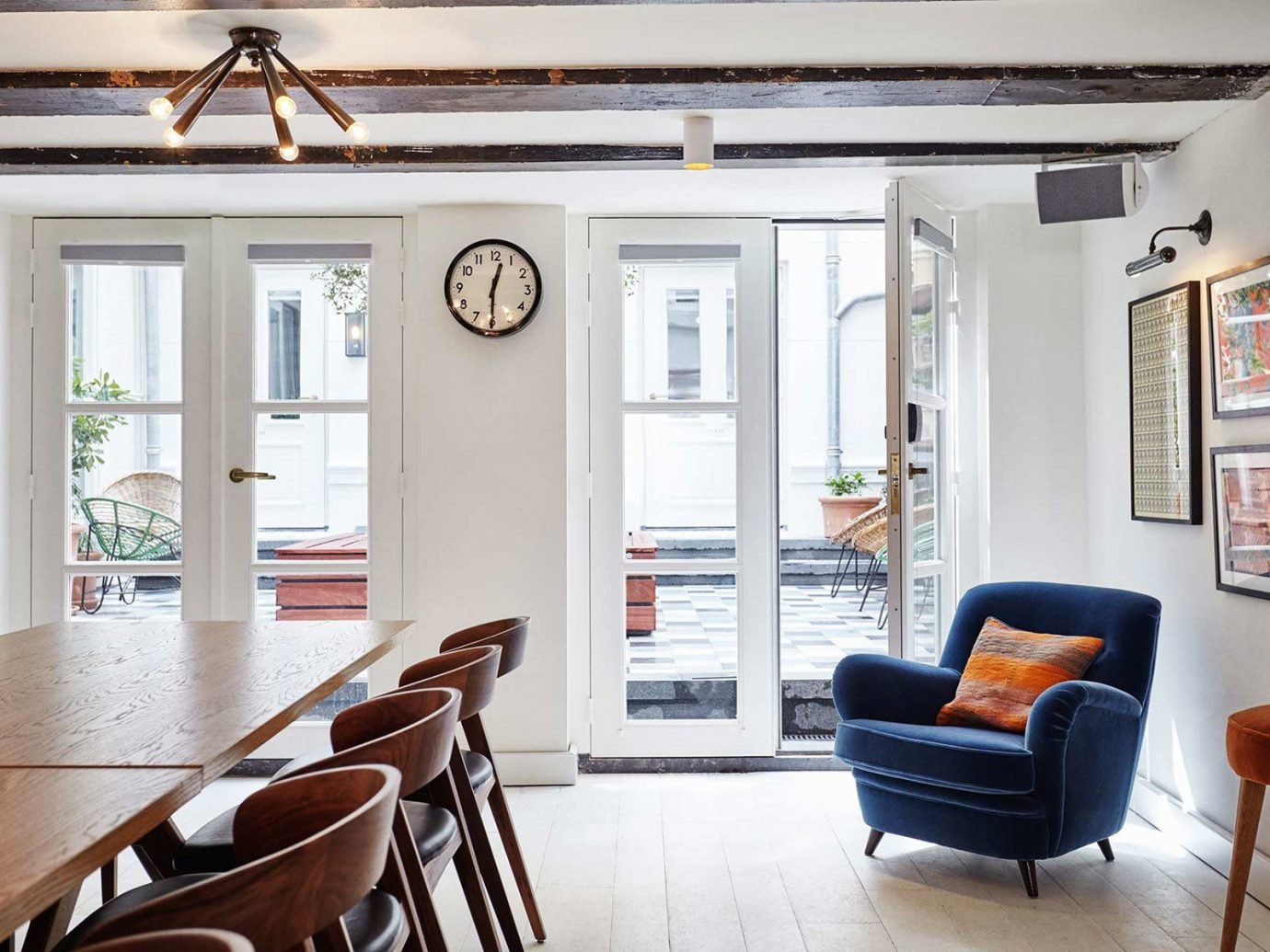 Amsterdam Hotels Style + Design The Netherlands Travel Shop indoor floor wall chair room property Living living room home dining room house estate interior design hardwood real estate cottage furniture window Dining Design window covering farmhouse loft apartment area