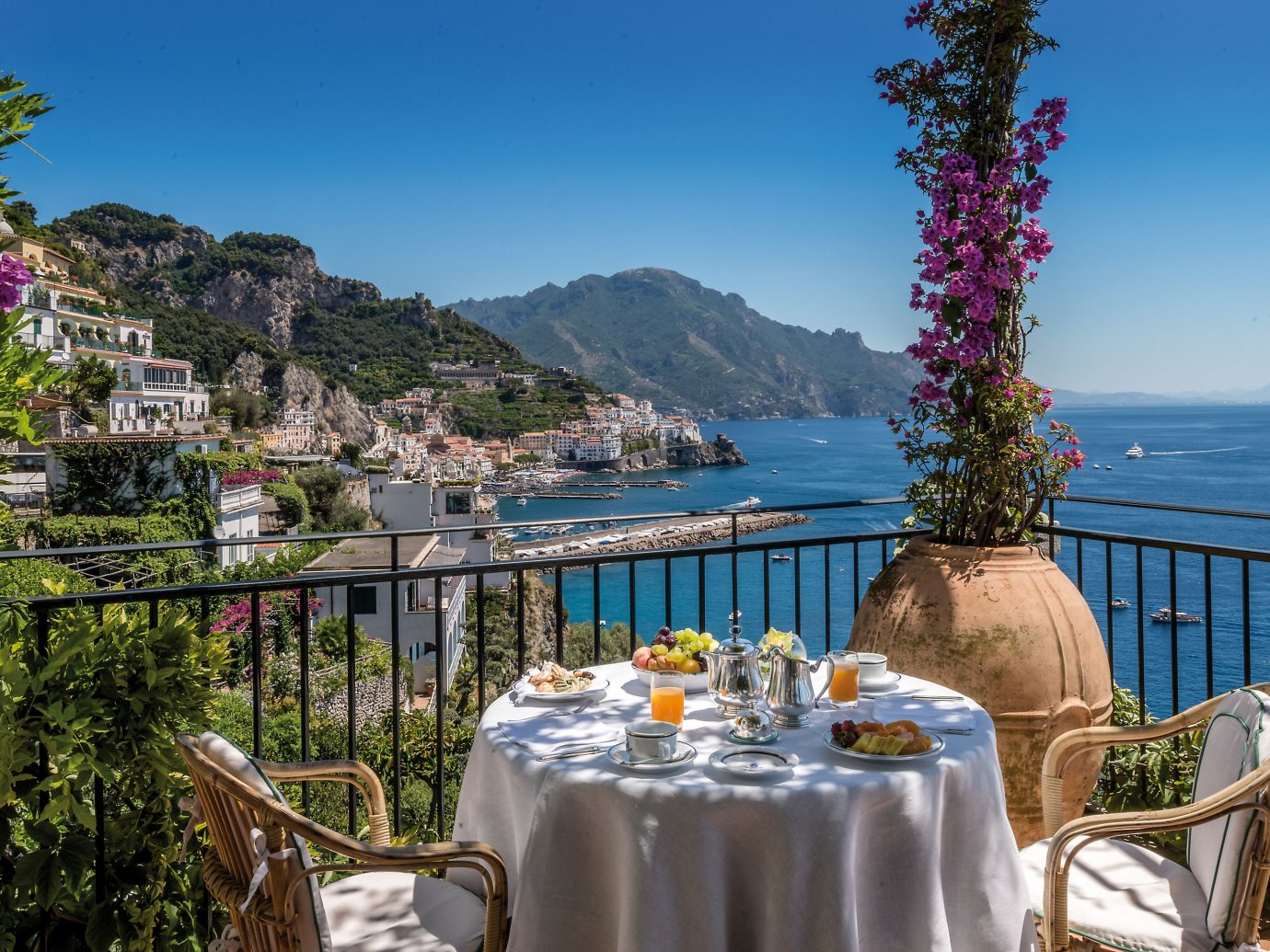 Honeymoon Hotels Luxury Travel Romance tree table sky outdoor water plant Sea vacation tourism Resort real estate leisure landscape mountain overlooking meal
