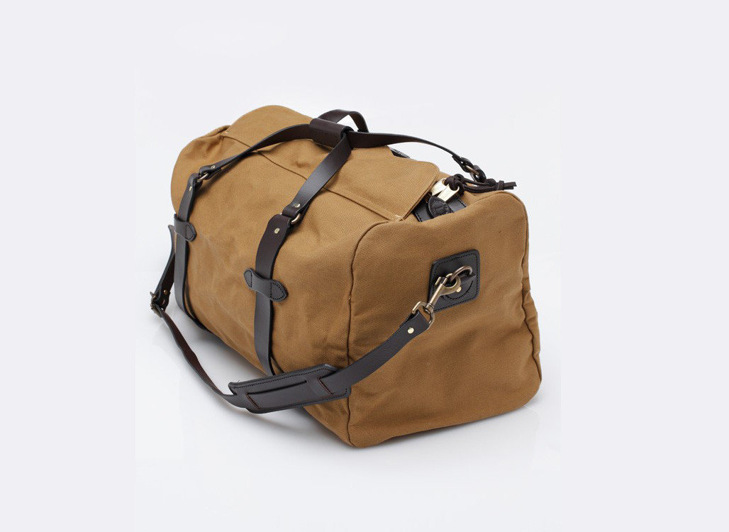 Packing Tips Style + Design Travel Shop bag luggage indoor suitcase piece brown product accessory shoulder bag leather beige handbag product design hand luggage