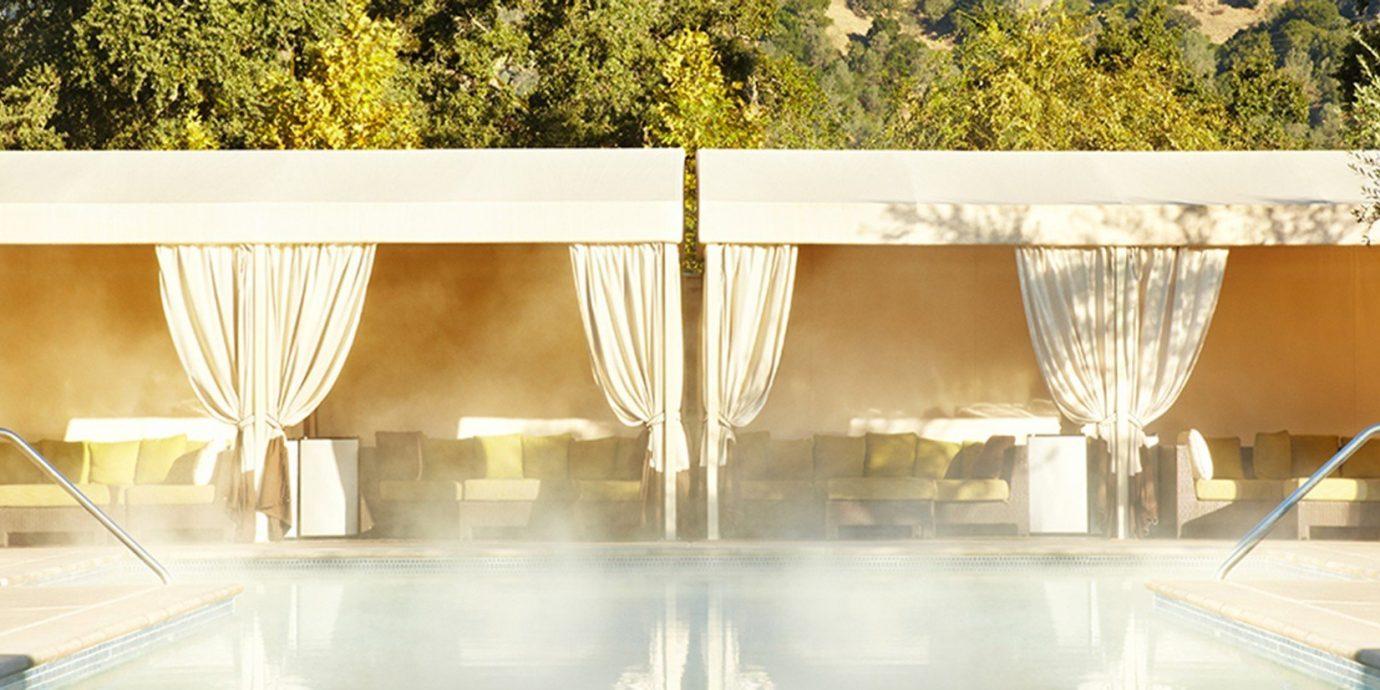 Health + Wellness Hotels Spa Retreats Trip Ideas tree interior design tent Design furniture swimming pool