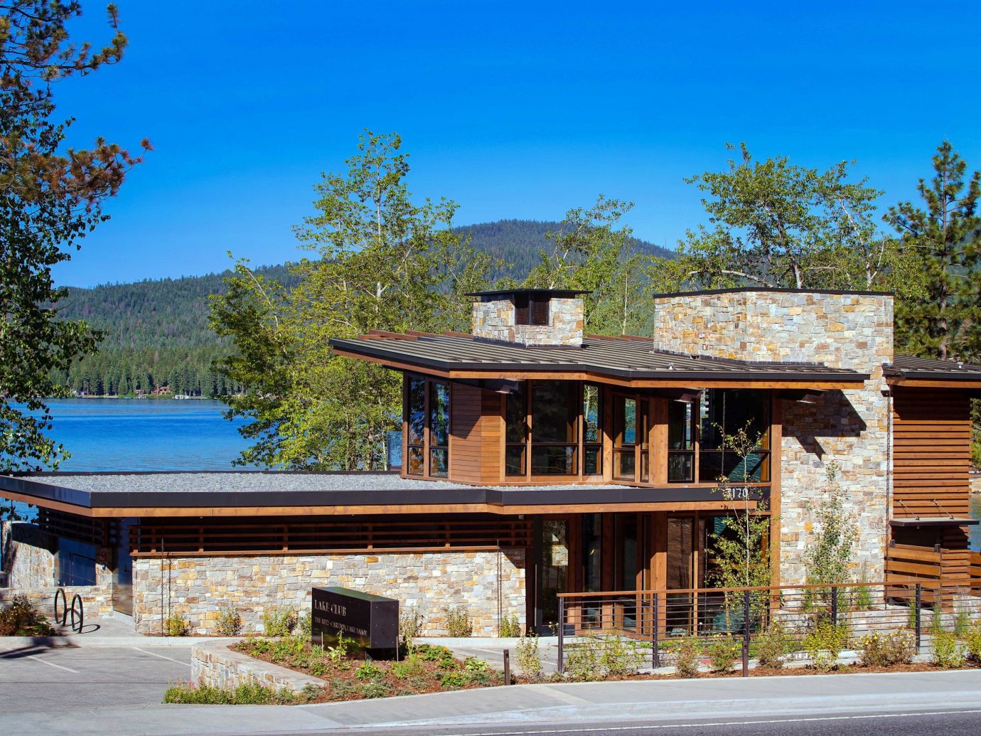 Lake Club house home property Architecture real estate cottage residential area tree estate facade plant landscape roof elevation Villa siding outdoor structure sky log cabin