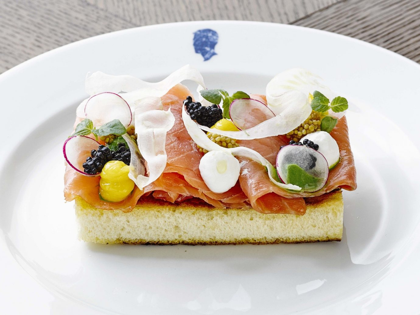 Hotels Travel Tips plate food table dish meal breakfast slice smoked salmon cuisine white canapé bruschetta produce hors d oeuvre toast prosciutto sliced dessert arranged