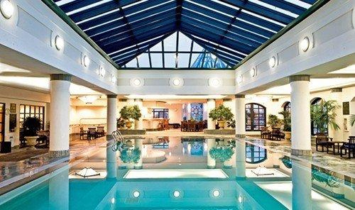 Travel Tips indoor swimming pool ceiling property leisure window Resort estate leisure centre condominium home real estate interior design mansion