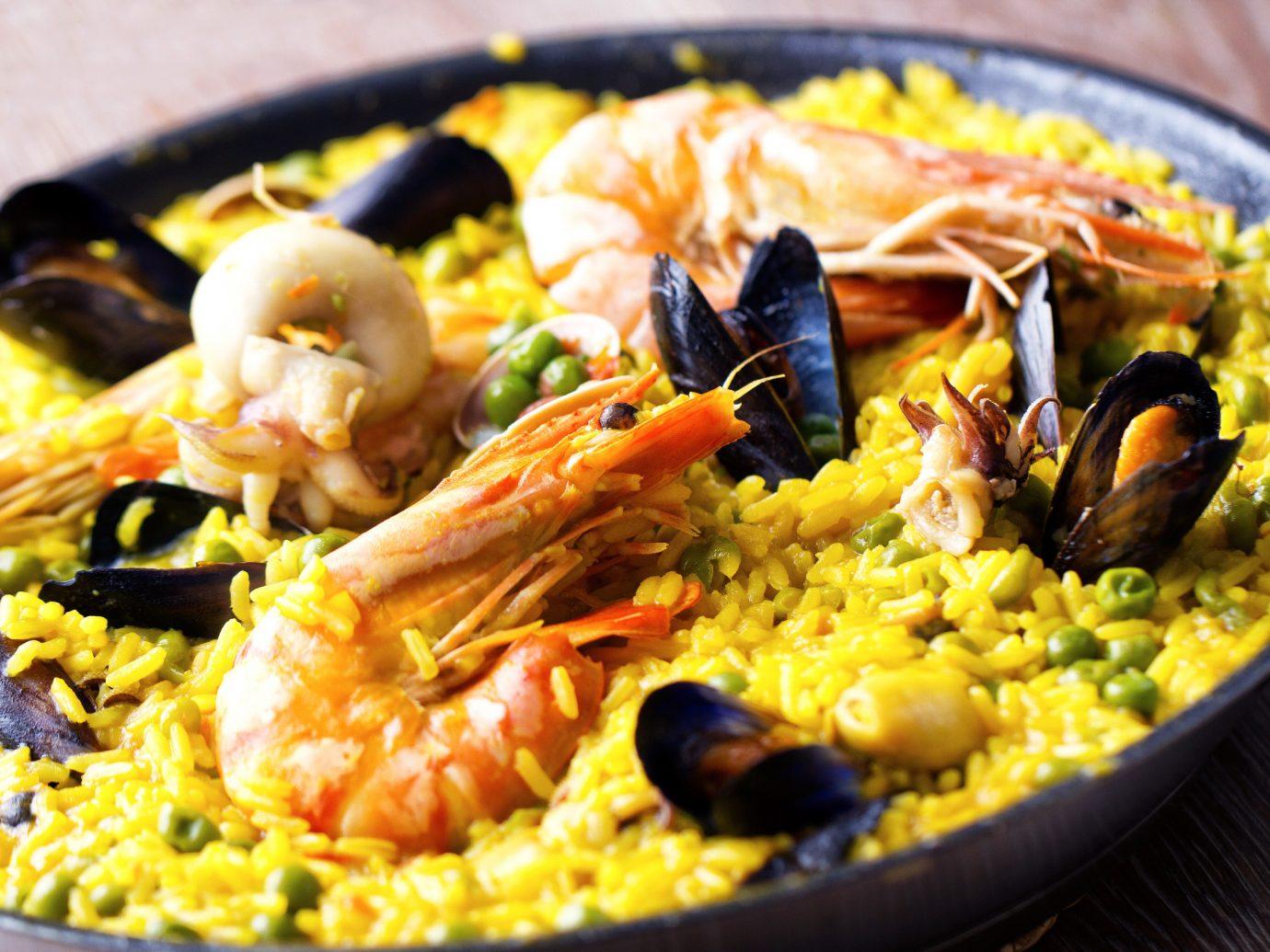 Dining Eat Food + Drink Resort food paella dish plate cuisine meal asian food european food thai food spanish cuisine fried rice