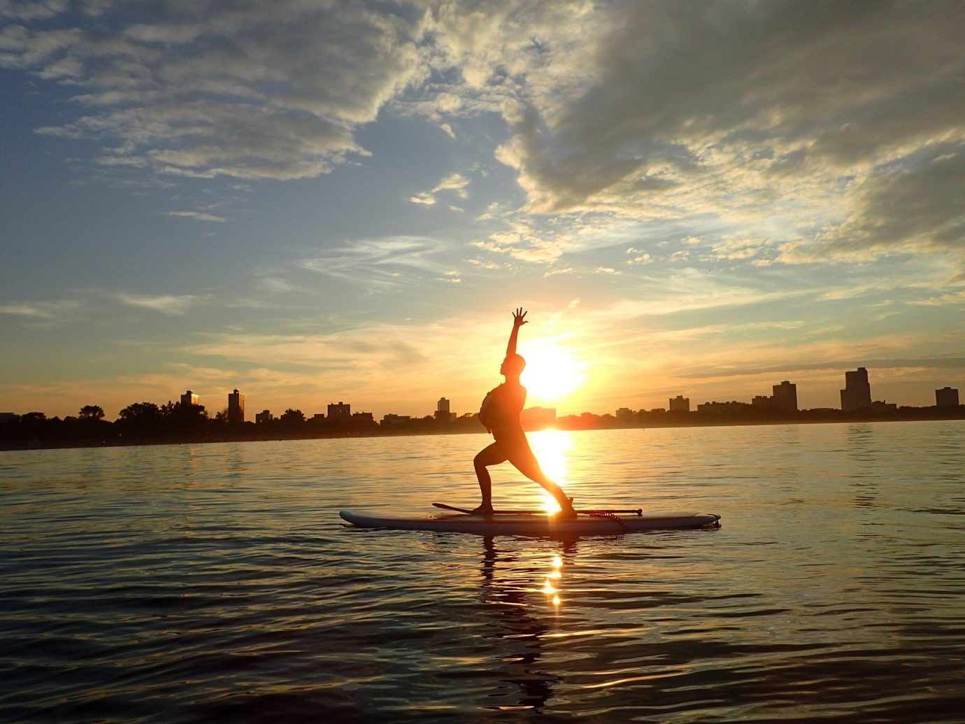 City city views fun glow golden hour Lake orange sky Outdoor Activities Outdoors paddleboarding people remote silhouette Sunset Trip Ideas Water activities Water Sports sky outdoor water Sea horizon cloud morning sunlight Ocean evening sunrise dusk Nature Sun Beach paddle dawn shore sailing vessel
