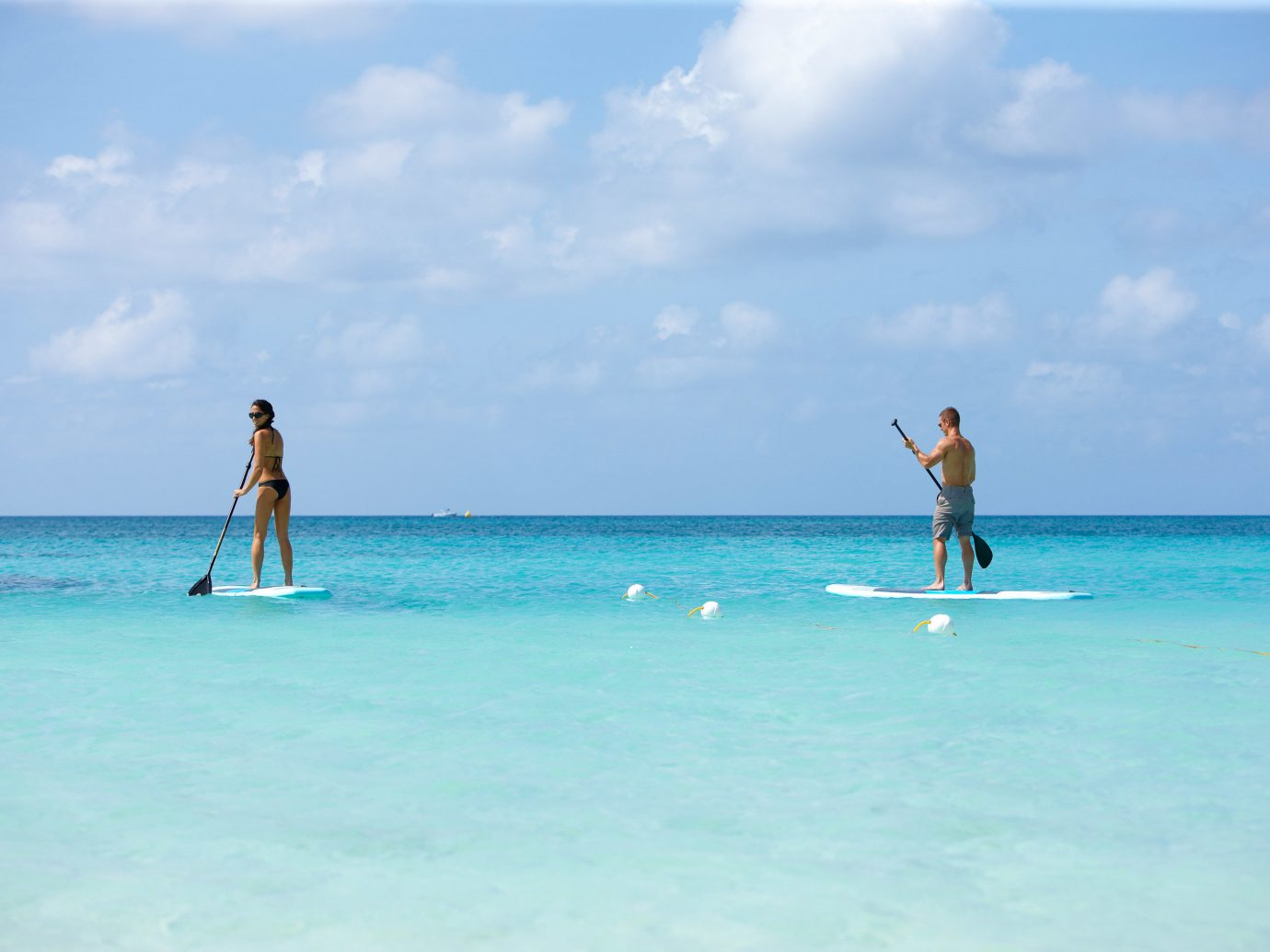 Hotels sky water outdoor Sea Beach blue Ocean body of water vacation caribbean shore wind wave Nature Island cape Coast wave Lagoon bay surfing equipment and supplies day