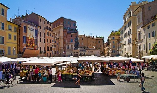 Food + Drink outdoor building road sky street Town City geographical feature plaza people public space neighbourhood human settlement market town square tourism Downtown infrastructure pedestrian cityscape carriage drawn