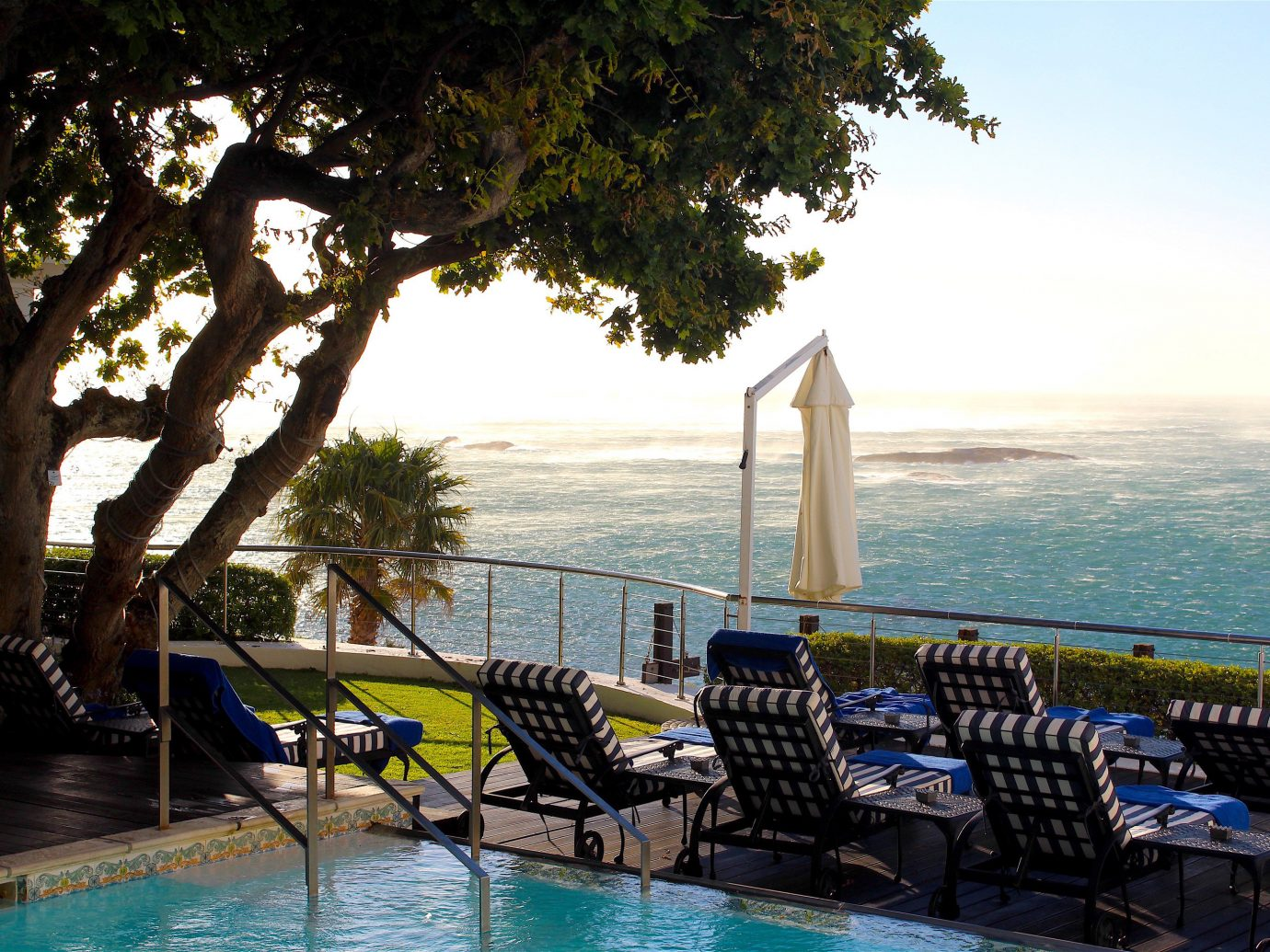 Outdoors + Adventure Safaris Trip Ideas tree water outdoor sky leisure swimming pool vacation Sea Resort estate caribbean bay overlooking lined shore