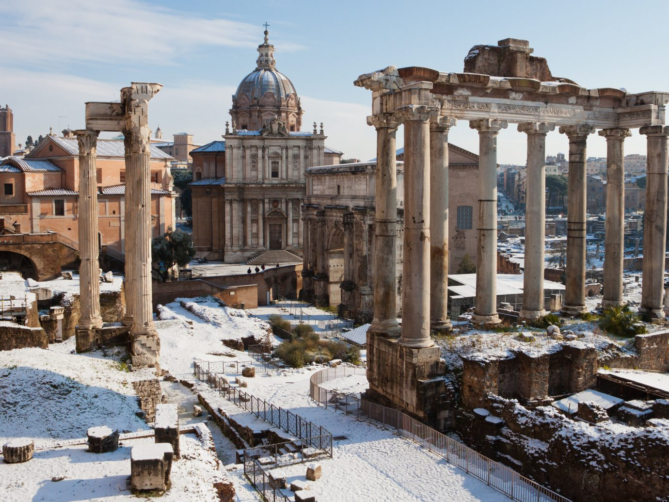 Boutique Hotels Romance Trip Ideas outdoor snow building ancient history Ruins ancient rome ancient roman architecture history historic site archaeological site Winter City tourist attraction sky plaza column facade ruin day colonnade