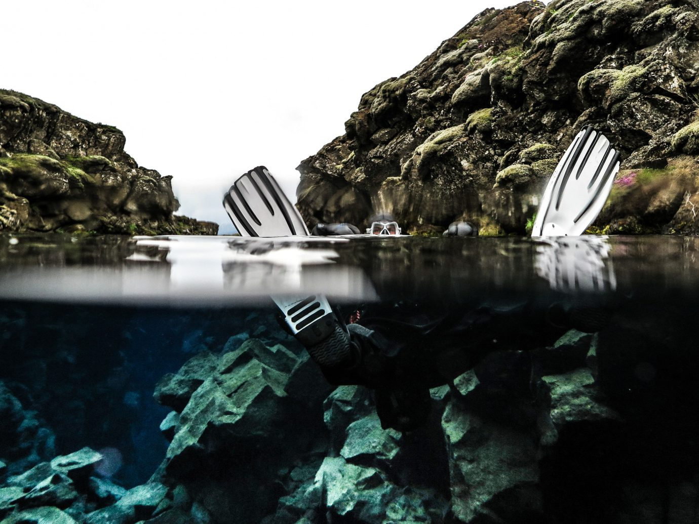 Iceland Travel Tips rock outdoor mountain water reflection rocky fjord water feature Lake terrain