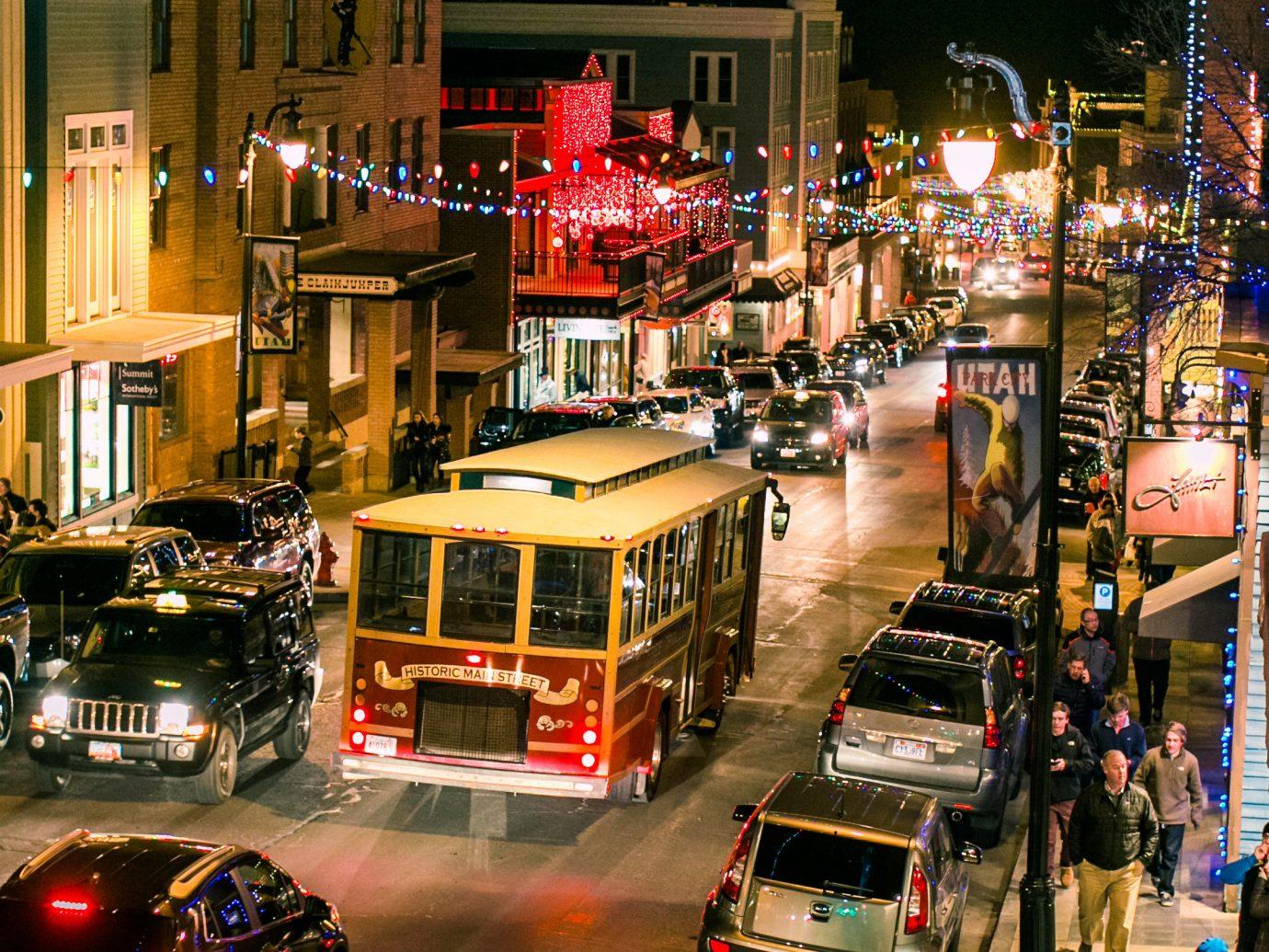 Mountains + Skiing Trip Ideas night City transport street traffic Downtown metropolis