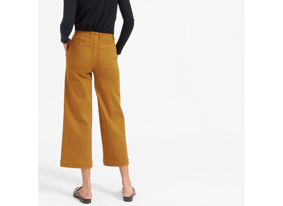 Style + Design Travel Shop person yellow standing waist active pants trousers abdomen trouser