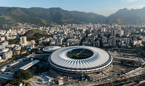 Jetsetter Guides mountain sky outdoor structure geographical feature bird's eye view City landmark sport venue stadium human settlement aerial photography soccer specific stadium arena panorama cityscape