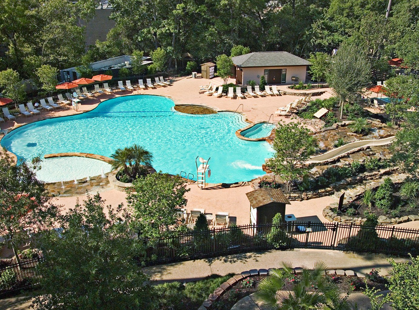 Elegant Grounds Jetsetter Guides Patio Pool Rustic Terrace tree outdoor leisure Resort swimming pool estate vacation lawn amusement park park Water park Garden lined