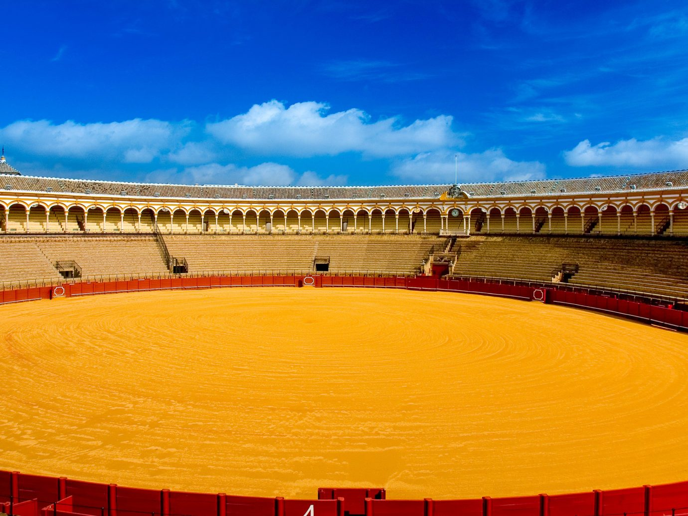 Offbeat sky sport venue stadium amphitheatre landmark building bullring yellow outdoor structure arena landscape